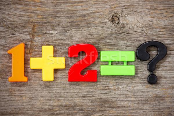 Matemáticas ejemplo plástico números color madera Foto stock © Grazvydas