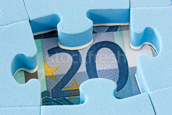 Blue puzzle on Euro currency Stock photo © Grazvydas