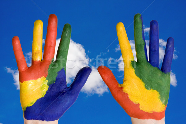 painted hands on blue sky background Stock photo © Grazvydas