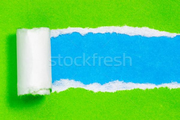 Torn зеленый цвета бумаги синий пространстве Сток-фото © Grazvydas