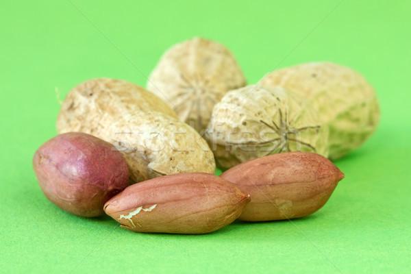 peanuts over a green background Stock photo © Grazvydas
