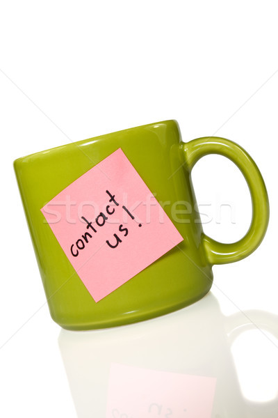 green cup with note 'contact us!' Stock photo © Grazvydas