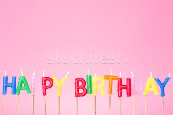 Coloré joyeux anniversaire bougies rose fête design Photo stock © Grazvydas