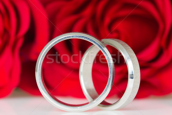 two silver rings with red roses Stock photo © Grazvydas