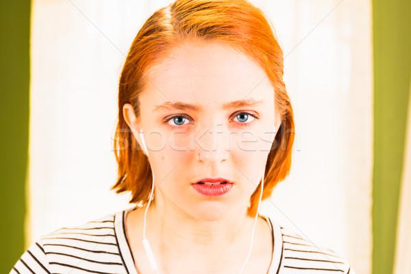小さな 赤毛 少女 ヘッドホン 見える カメラ ストックフォト © gregorydean