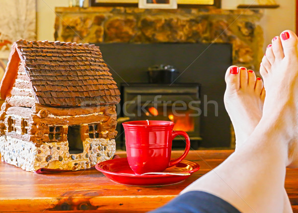 Feet Resting by the Fire With a Cup of Tea Stock photo © gregorydean