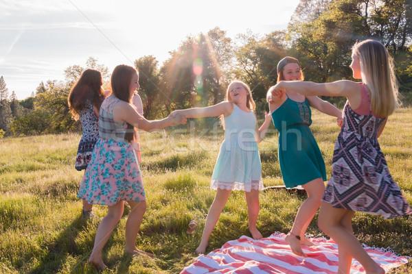 Lányok tánc füves mező napfény fiatal Stock fotó © gregorydean