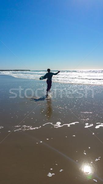 少女 を実行して 波 若い女の子 ビーチ 海 ストックフォト © gregorydean