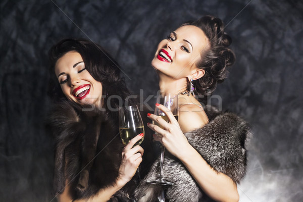 Joy. Elation. Rich woman laughing with crystal of champagne Stock photo © gromovataya