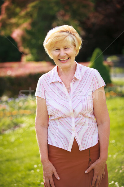 Elegance. Elation. Happy Senior Woman Outside with Toothy Smile Stock photo © gromovataya