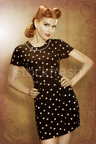 Pin-Up retro girl in classic fashion polka dots dress posing Stock photo © gromovataya