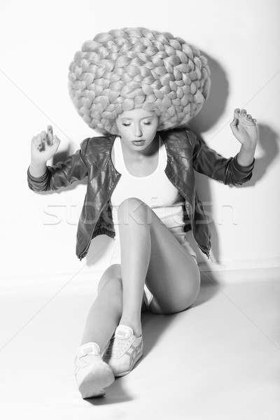 Creativity. Trendy Woman in Huge Fancy Wig sitting on Floor Stock photo © gromovataya