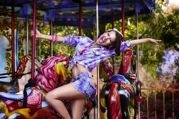 Funfair. Cheerful Woman in Amusement Park on Carousel. Enjoyment Stock photo © gromovataya