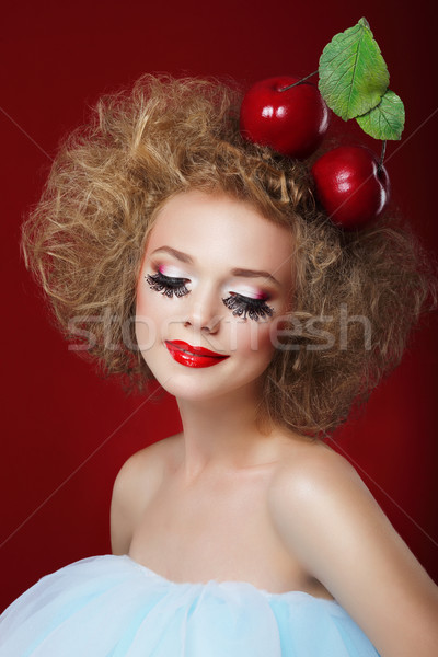 Grotesque. Humorous Woman with Red Apples and Fancy Makeup Stock photo © gromovataya