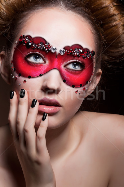Painted Face. Beautiful Girl in Red Carnival Mask. Masquerade Stock photo © gromovataya