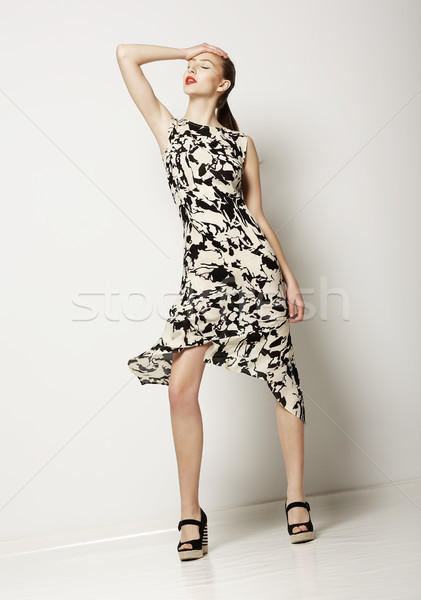 Fashion Woman in Light Spotty Dress. Design of Contemporary Apparel Stock photo © gromovataya