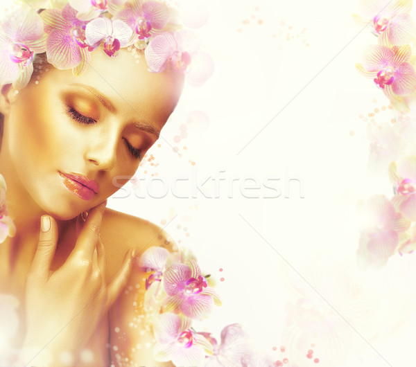 Relaxation. Dreamy Genuine Exquisite Woman with Flowers. Romantic Floral Background Stock photo © gromovataya