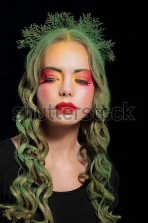 Imagination. Woman with Dyed hair and Fancy Creative Makeup Stock photo © gromovataya