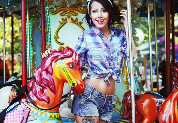 Rejoicing. Merriment. Excited Lively Woman in Funfair Smiling Stock photo © gromovataya