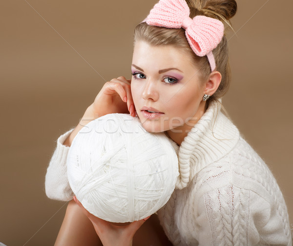 Pure Beauty. Woman in White Fluffy Knitted Pullover with Hank of Thread Stock photo © gromovataya