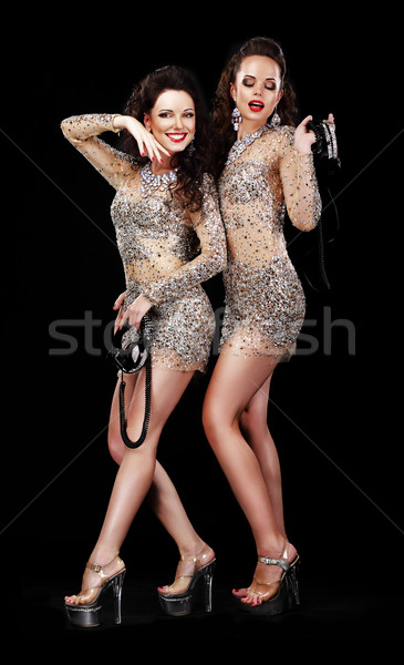 Performance. Two Happy Women in Theatrical Costumes on Platform Shoes Stock photo © gromovataya