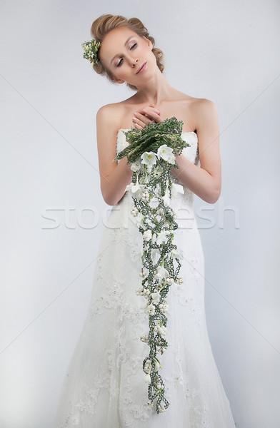 Pretty woman fiancee blond with bunch of fresh gentle flowers Stock photo © gromovataya