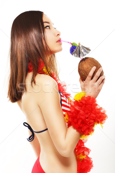 Japanese Woman Drinking Exotic Cocktail through the Straw and Relaxing. Travel Concept Stock photo © gromovataya