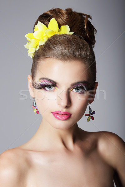 Eccentric Showy Woman with Vivid Colorful Makeup and False Long Eyelashes Stock photo © gromovataya