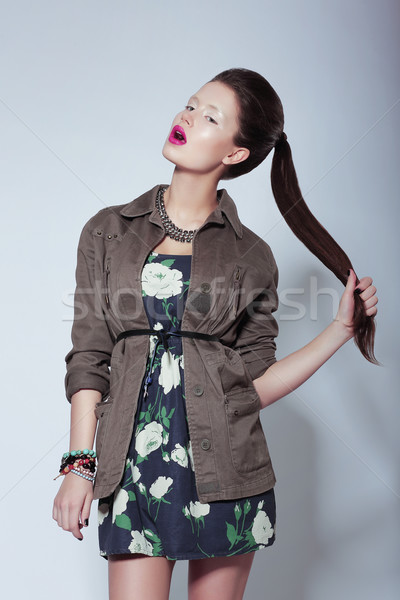 Trendy Fashion Model in Elegant Clothes holding her Tress Stock photo © gromovataya