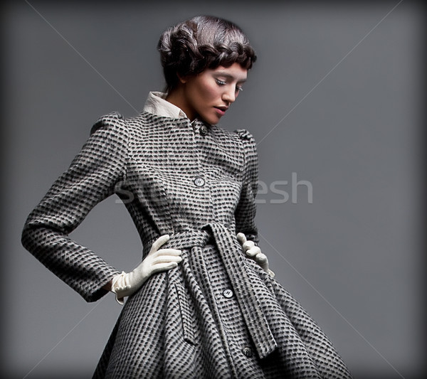 Stock photo: Nostalgia. Romantic Lady in Classic Coat Daydreaming. Pinup Style