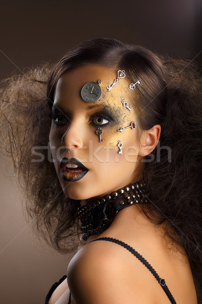 Futurism. Bodyart. Golden Painted Woman's Skin with Silver Accessory. Art Deco Stock photo © gromovataya