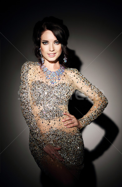 Glam. Successful Lady in Silver Evening Dress  over Black Stock photo © gromovataya