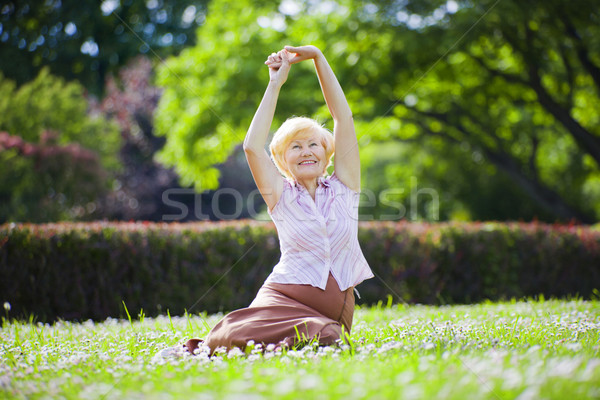 Wellness. Mental Health. Optimistic Old Woman Exercising in Open Air Stock photo © gromovataya