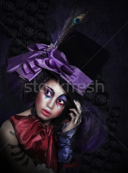 Expression. Pantomime. Clown in Fancy Carnival Hat with Artistic Makeup Stock photo © gromovataya