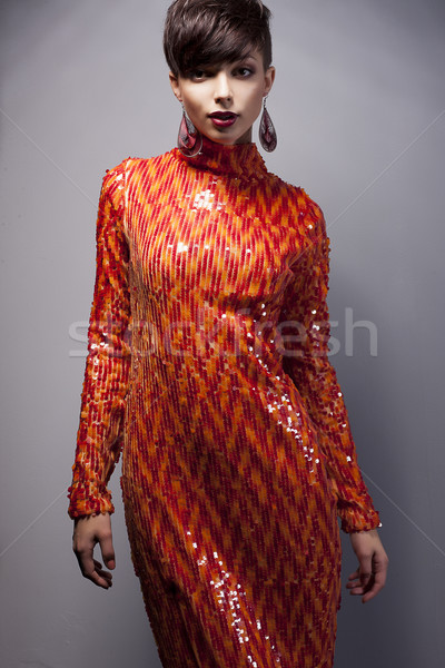 Fashion Style - Luxurious Woman in Red Dress with Strass posing Stock photo © gromovataya