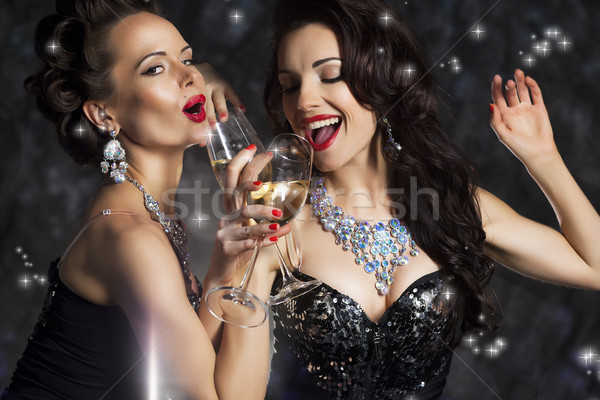 Happy Laughing Women Drinking Champagne and Singing Xmas Song Stock photo © gromovataya