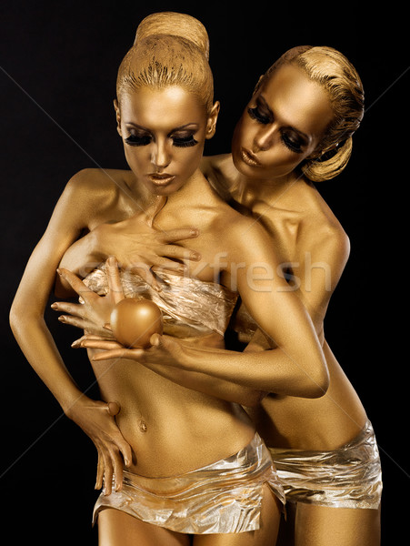 Glitter. Glaze. Seductive Women with Golden Bodies Hugging. Fantasy Stock photo © gromovataya