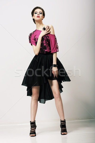 Tendency. Glamorous Fashion Model in Modern Clothes posing in Studio Stock photo © gromovataya
