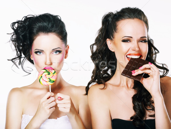 Burlesque. Parody. Couple of Women Sneers and showing a Fig Stock photo © gromovataya