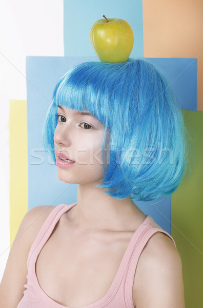 Imagination. Asian Woman in Blue Wig with Apple on her Head Stock photo © gromovataya