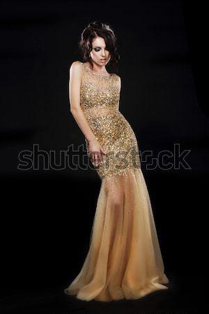 Lovely bride brunette in white dress standing in studio posing Stock photo © gromovataya