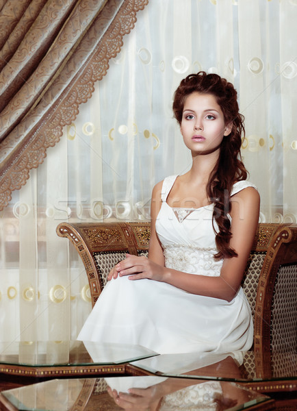 Femininity. Brown Hair Woman Bride in Wedding Dress sitting. Classic Romantic Interior Stock photo © gromovataya