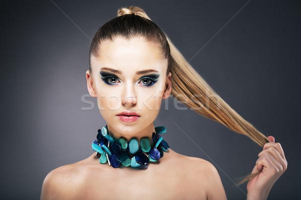 Treatment. Woman holding Tips of her long faint Hair in hand Stock photo © gromovataya