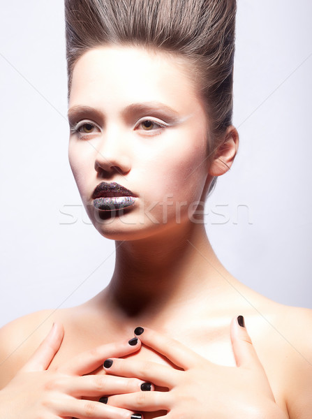 Portrait of young woman with creative make-up and coiffure Stock photo © gromovataya