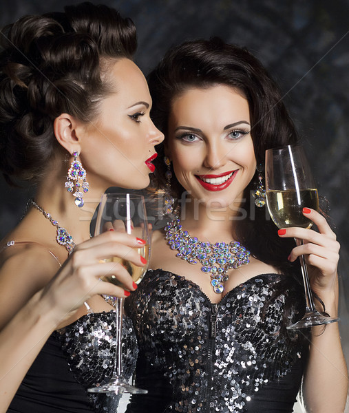 Christmas. Fashion women with wine glasses of champagne Stock photo © gromovataya