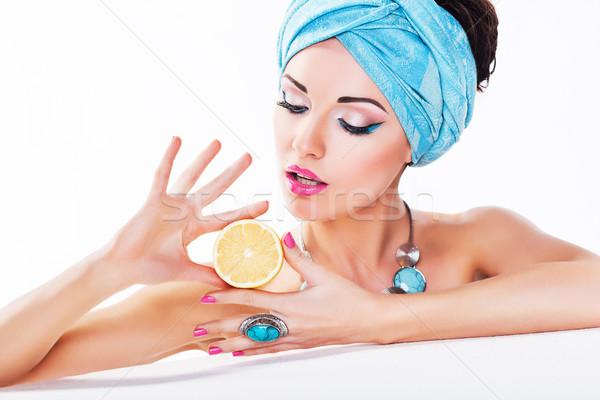 Stock photo: Beauty Woman Holding a Fresh Lemon in Hands - Clean Healthy Skin