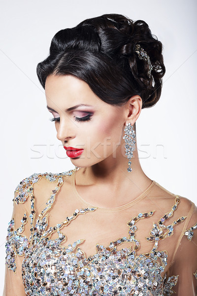 Formal Party. Gorgeous Fashion Model in Ceremonial Shiny Dress with Jewels Stock photo © gromovataya