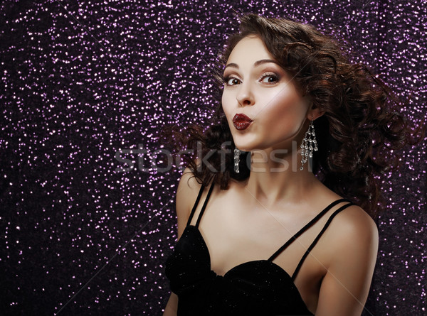 Coquette. Playful Young Woman Blowing a Kiss. Frizzy Hair Stock photo © gromovataya