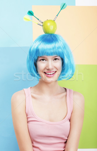 Precision. Amusing Woman in Blue Wig, Green Apple and Darts Stock photo © gromovataya