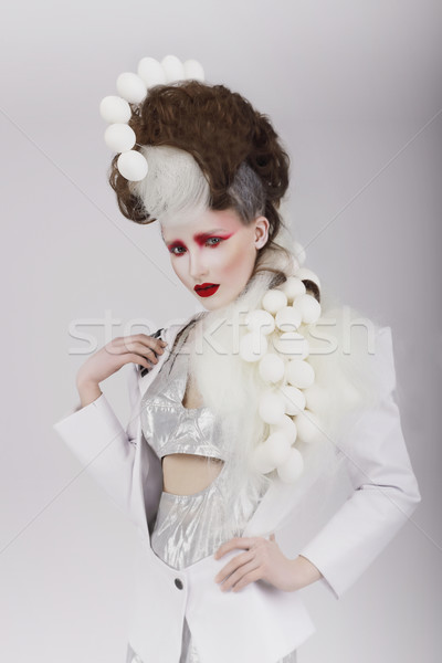 Haute Couture. Extravagant Woman in Cyber Costume and Theatrical Hair-do Stock photo © gromovataya